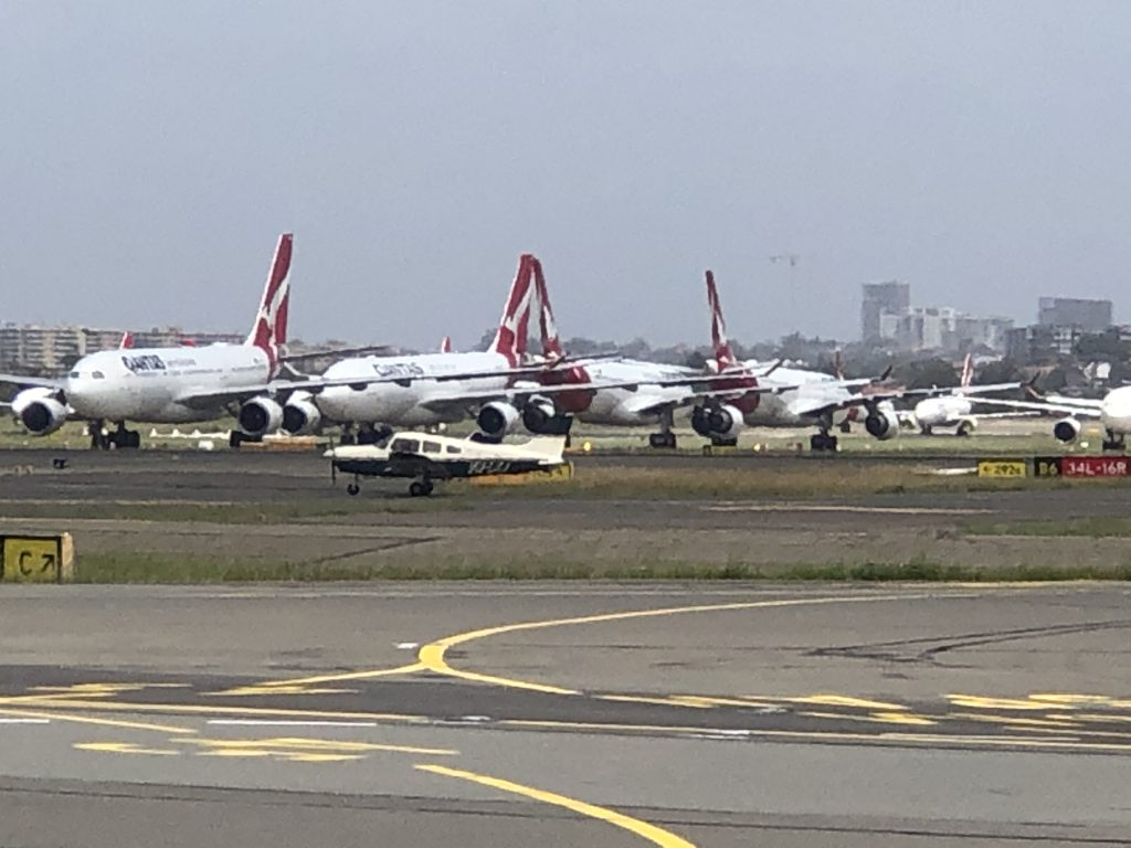 Lisa Pagotto's Piper Warrior dwarfed by the Qantas temporary graveyard and sheer size of the oversized runway
