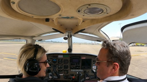 We made it! Lisa Pagotto and flight instructor Kevin Williams land in Sydney's Kingsford Smith Airport